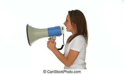 Furious young girl yelling into a megaphone with an angry...