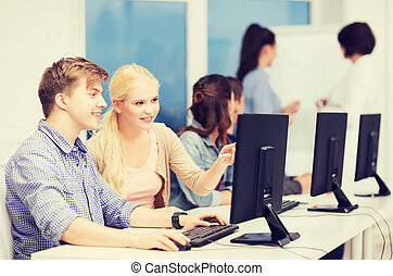 students with computer monitor at school