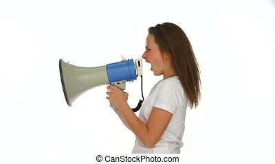 Angry young girl yelling into a megaphone - Angry young girl...