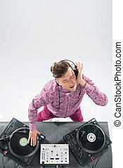 Top view portrait of dj mixing and spinning turntable - Top...