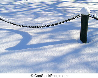 Chain under snow - Chain of the fence covered with snow...