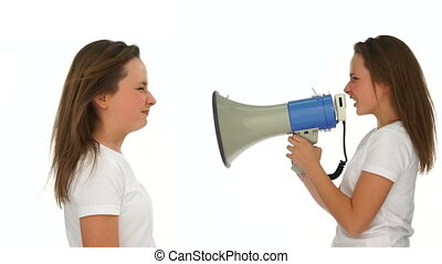 Young girl yelling at herself with a megaphone - Young girl...