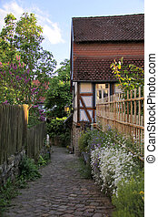 Narrow lane with garden fence in Idstein in Hesse, Germany