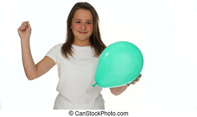 Young girl about to prick a party balloon - Playful...