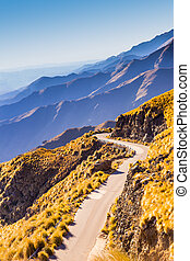 Winding mountain road - Scenic winding road on cliffs of...