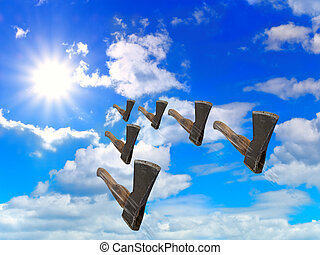 reactive axes flying in blue cloudy sky with sun