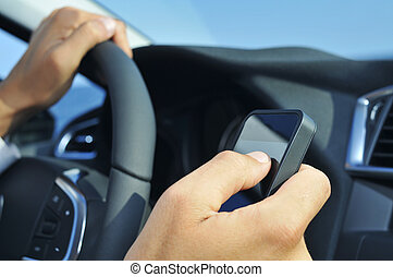 man using a smartphone while driving a car - closeup of a...