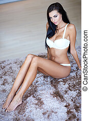 Woman Wearing Lingerie Sitting on Rug on Floor - Sexy Woman...
