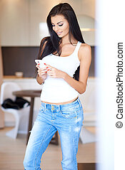 Attractive woman reading a text message - Attractive sexy...