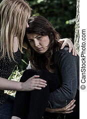 Woman hugging her worried friend - Young woman hugging her...