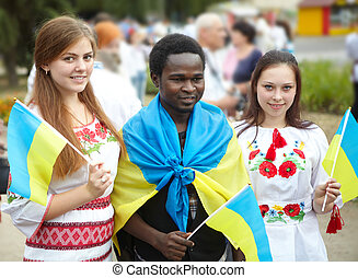 The young african man and white girls. The Ukraine