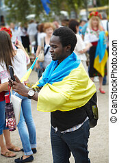 The young african man with a telephone. The Ukraine