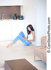 Young woman relaxing on the floor in a living room