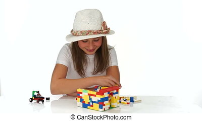 Young girl playing with colorful building blocks - Young...