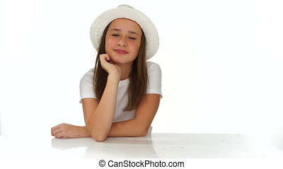Thoughtful young girl in a cute hat