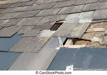damaged roof - hole in a roof due to storm or decay