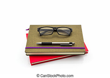 Pen and glasses sitting on book.