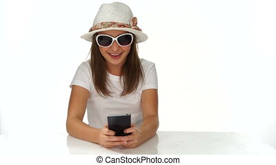 Trendy young teenager smiling as she reads an sms
