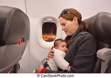 Newborn Baby air travel - Mother carry her newborn baby...