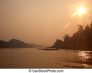 Haze over Borneo river, flare intentional