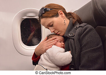 Newborn Baby air travel - Mother hug and sleep with her...