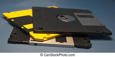 Floppy disks - Multi-coloured Floppy disks on a dark blue...