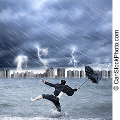 businessman holding an umbrella with thundershower