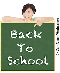 Back to school, young student girl point to blackboard