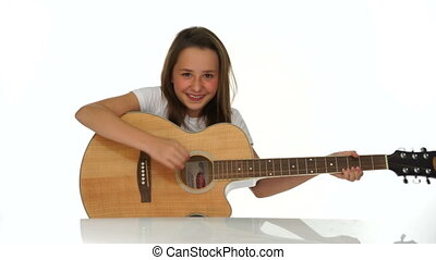Young girl playing a wooden guitar