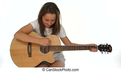 Musical young girl with her wooden guitar
