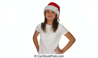 Pleased young girl in a Christmas Santa hat - Pleased young...
