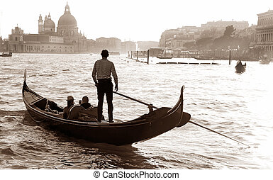 Gondolier Lagoon Venice - gondolier in the lagoon of Venice,...