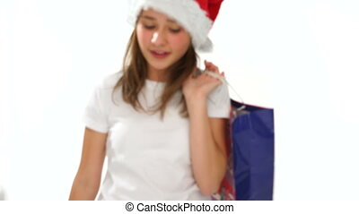 Cute little girl in a Santa Hat hugging a teddy - Cute...