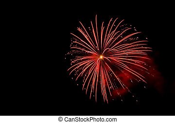 Fireworks - A red fireworks explosion with an orange center