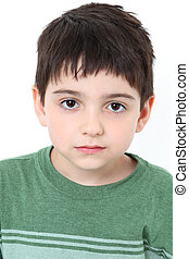 Serious Expression - Adorable six year old boy with serious...