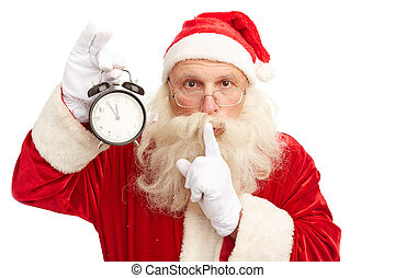 Waiting for Christmas - Santa Claus with alarm clock showing...