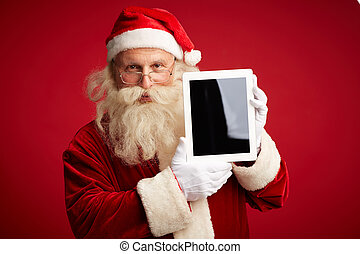 Santa with touchpad - Portrait of Santa Claus with...