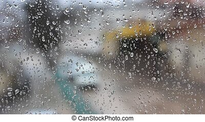 Water drops on window with traffic