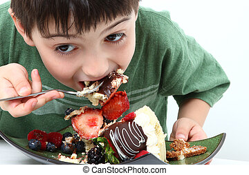 Boy Eating Cheesecake - Adorable six year old boy eating...