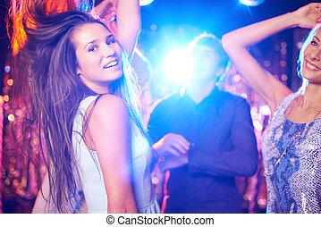 Dancing - Joyful girls and guys dancing in night club