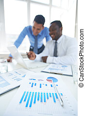 Financial chart - Business documents at workplace with two...