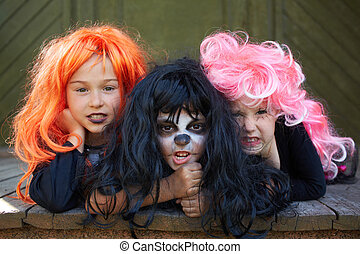 Dreadful friends - Portrait of three Halloween girls looking...