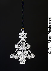 Chrtismas Ornament - A white Christmas tree ornament hanging...
