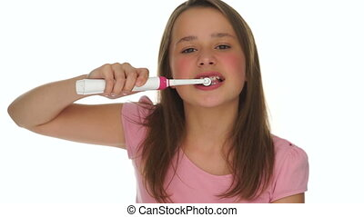 Girl Brushing Teeth Using Electric Toothbrush - Closeup of...