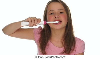 Girl Brushing Teeth Using Electric Toothbrush - Closeup of...