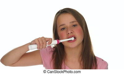 Young girl,using an electric tooth brush to clean her teeth...