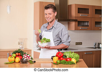 handsome man squeezing lime for fresh salad guy preparing...