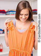 Beautiful girl trying dress and smiling closeup portrait of...