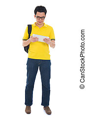 Asian adult student in casual wear with school bag using digital