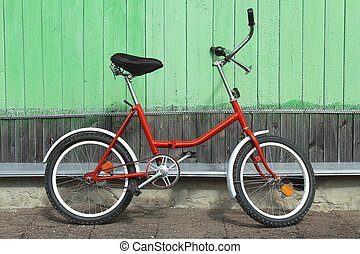 Red bicycle - Old red bicycle in the exterior of the...